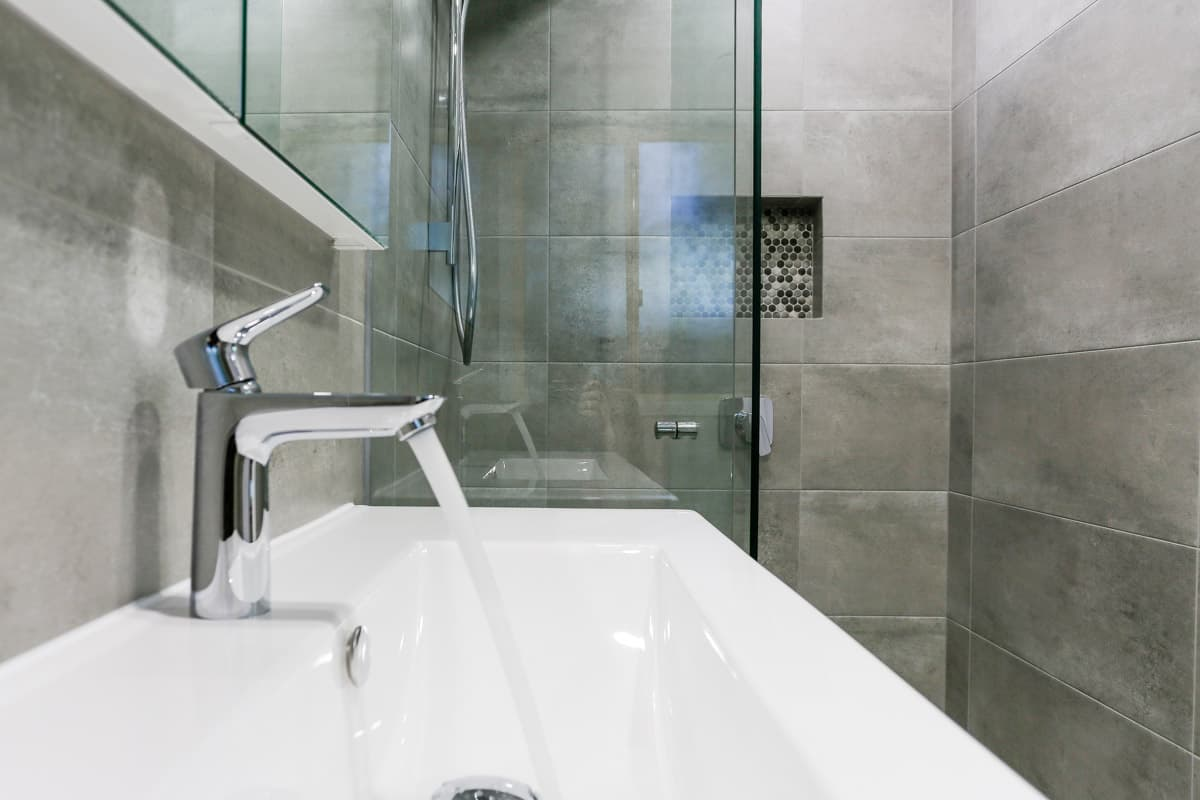 Small-bathroom-renovation-in-Sydney-with-walk-in-shower-and-HG-Talis-E-110-Basin-mixer-without-waste