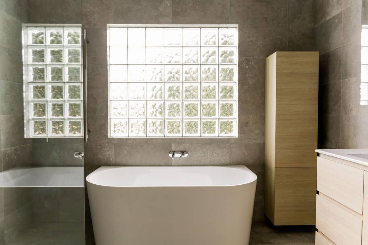 Full-bathroom-renovation-with-free-standing-bath-wall-hung-cupboard