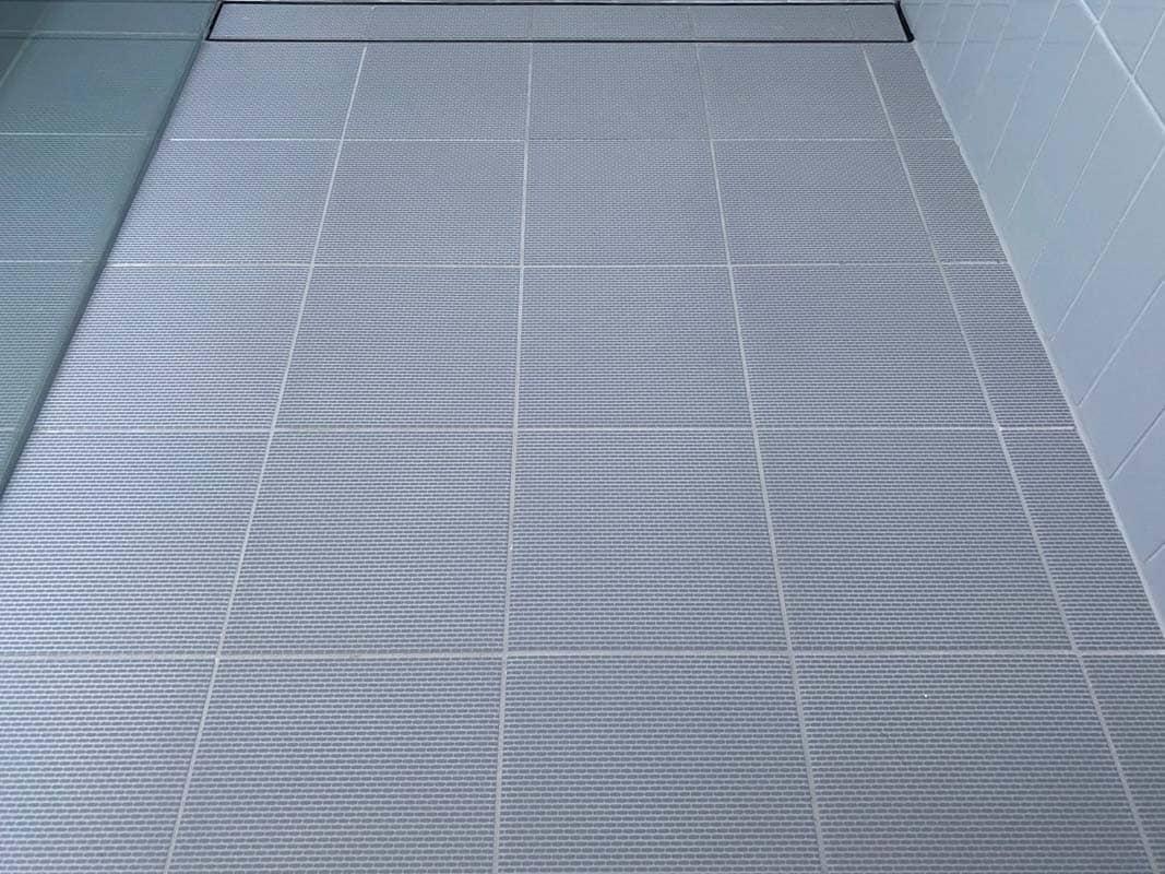 What-does-poor-quality-bathroom-renovation-look-like-floor-gradient