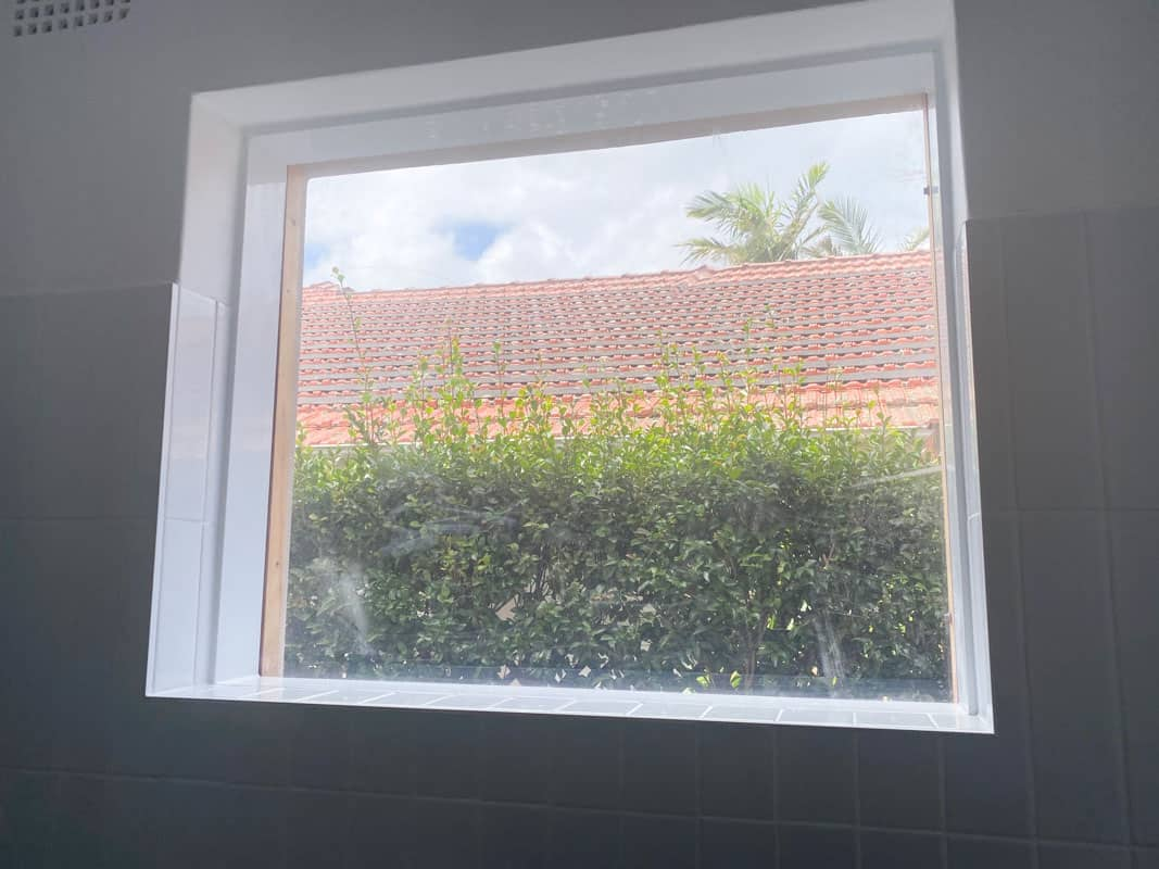 What-does-poor-quality-bathroom-renovation-look-like-window-not-installed-correctly