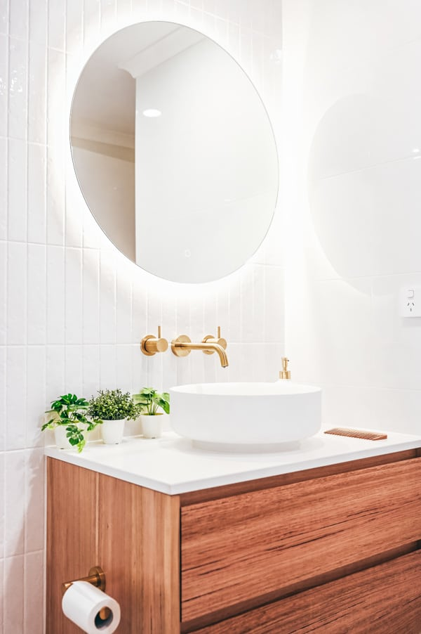Complete-Bathroom-Renovation-in-Sydney-with-terrazo-floor-tiles-by-Nu-Trend-renovating-contractor-install-a-Staples-Tasmanian-Oak-Vanity-and-LED-Mirror