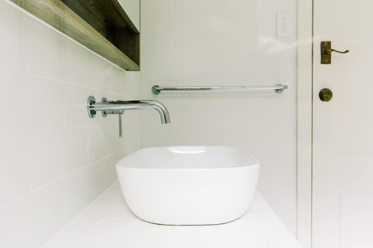Master-Bathroom-Renovation-in-Sutherland-with-COMO-Wall-Basin-Mixer-Spout-Chrome-Carrara-Stone-Top
