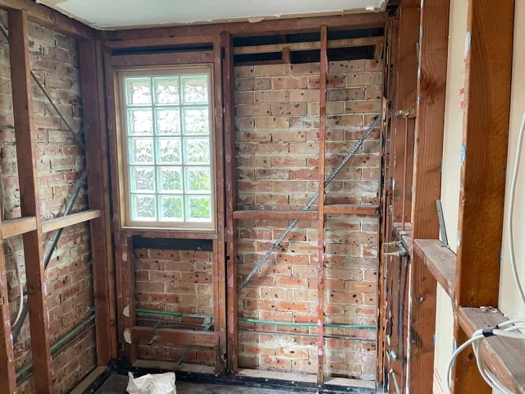 Sydney-Small-Bathroom-Renovation-behind-the-scenes-demolition-of-wall-tiles