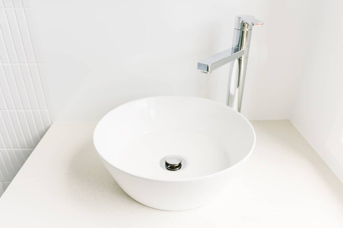 Sydney-Small-Bathroom-Renovation-with-ICE-SNOW-CAESARSTONE-TOP-SPACE-BOWL-and-tall-swivel-basin-mixer
