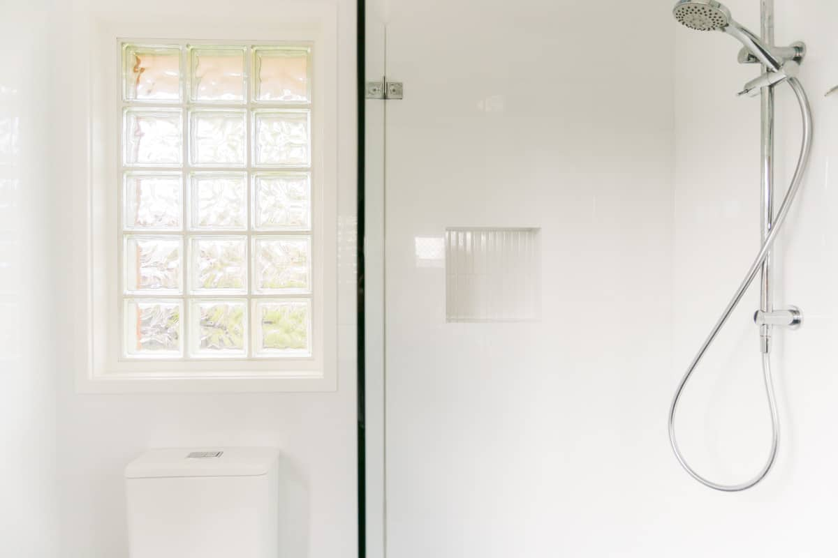 wall niche in a bathroom Sydney-Small-Bathroom-Renovation-with-PEGASI-600-DUAL-SHOWER-and-frameless-custom-shower-screen