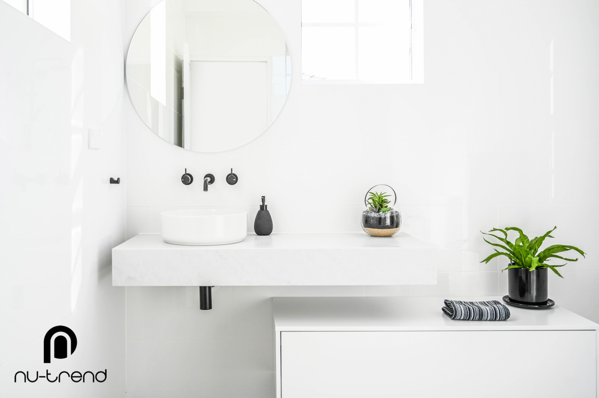 Nu Trend Sydney Renovation Company completed ensuite bathroom with laminate slab top with ceramic offset basin from Bathroom Collective