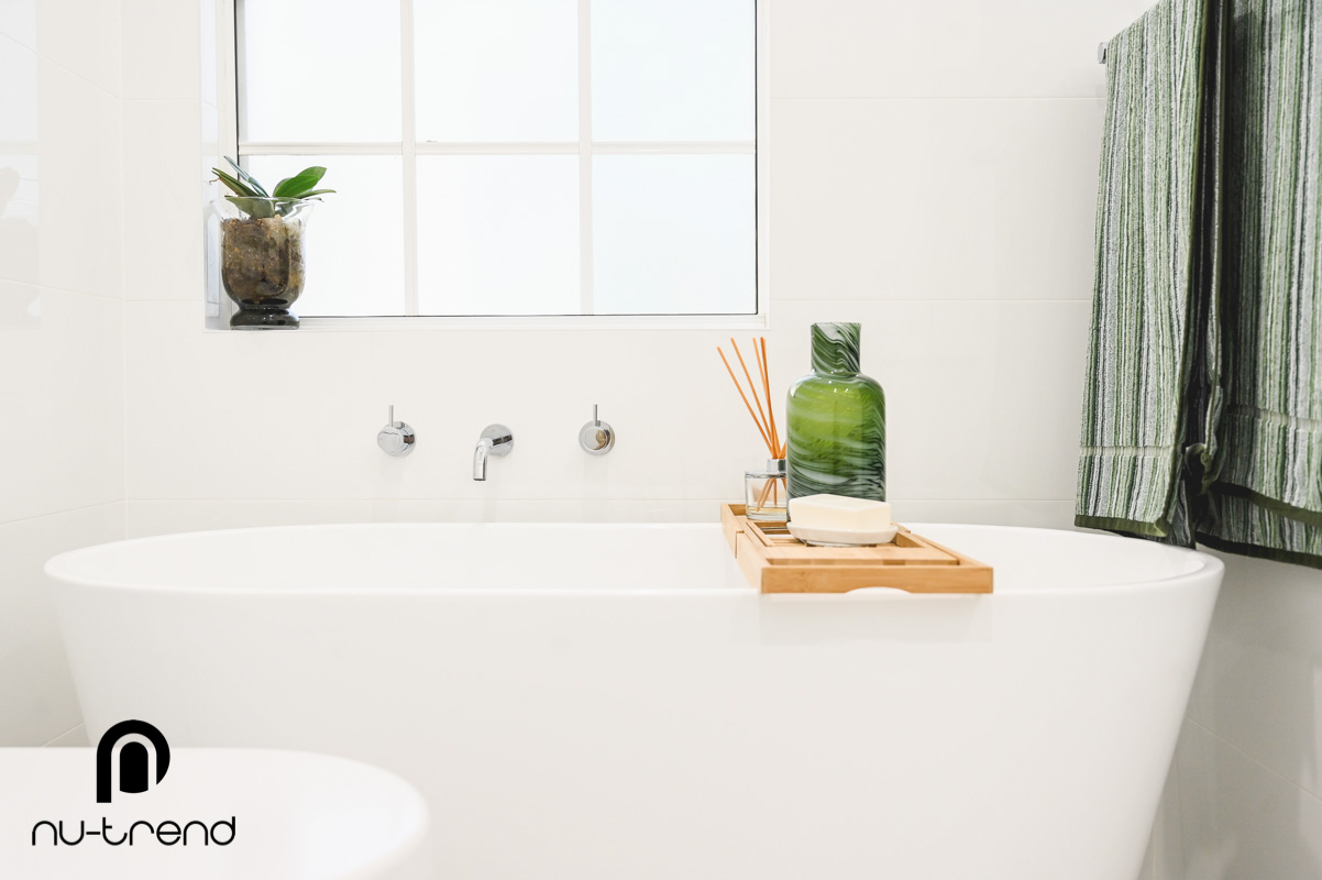 Nu Trend Sydney Renovation Company completed master bathroom with Arvo mm white bath from Bathroom Collective near a window