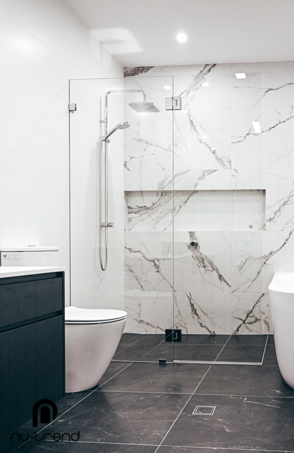 Master bathroom renovation upstairs shower and bath by Nu Trend in Greenhills Beach Sydney black Living Tiles Charisma Imperial Lappato x floor tiling