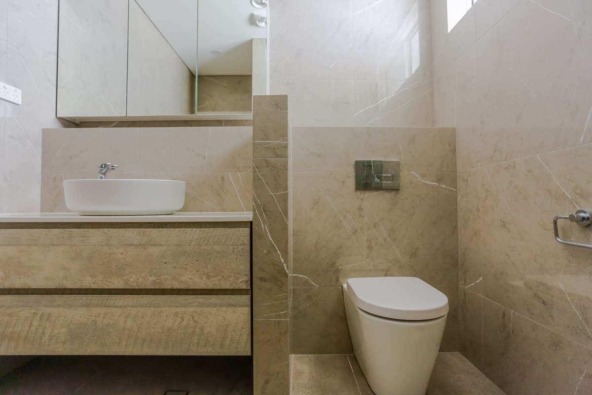 Bathroom-Renovation-in-Sylvania-Sydney-with-porcelain-marble-look-tiles-and-Kado-Lux-toilet-suite-