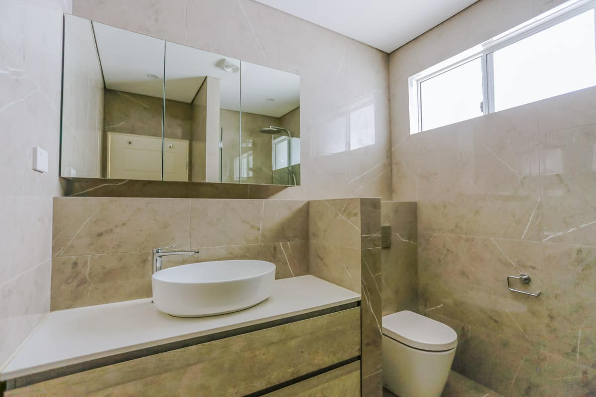 Bathroom-Renovation-in-Sylvania-Sydney-with-porcelain-marble-look-tiles-in-beige