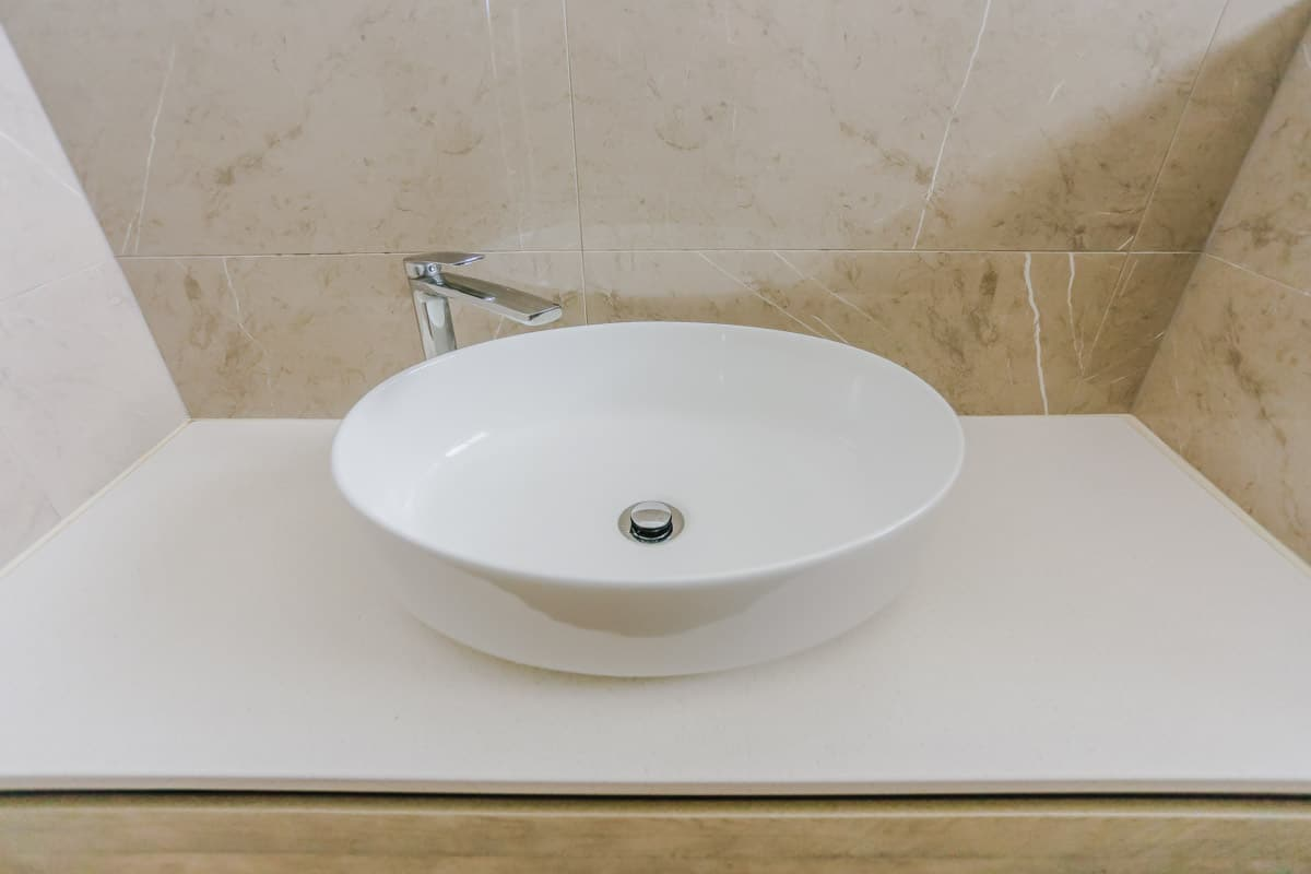 Bathroom-Renovation-in-Sylvania-Sydney-with-porcelain-marble-look-tiles-with-round-sink-1