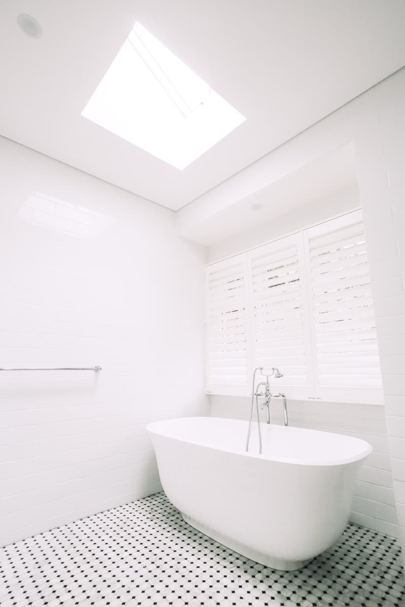 Master-Bathroom-Renovation-With-Freestanding-Bath-Tub-under-a-skylight