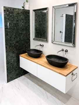 The twin vanity area of a bathroom renovation with bathrub by Nu-Trend in Sydney