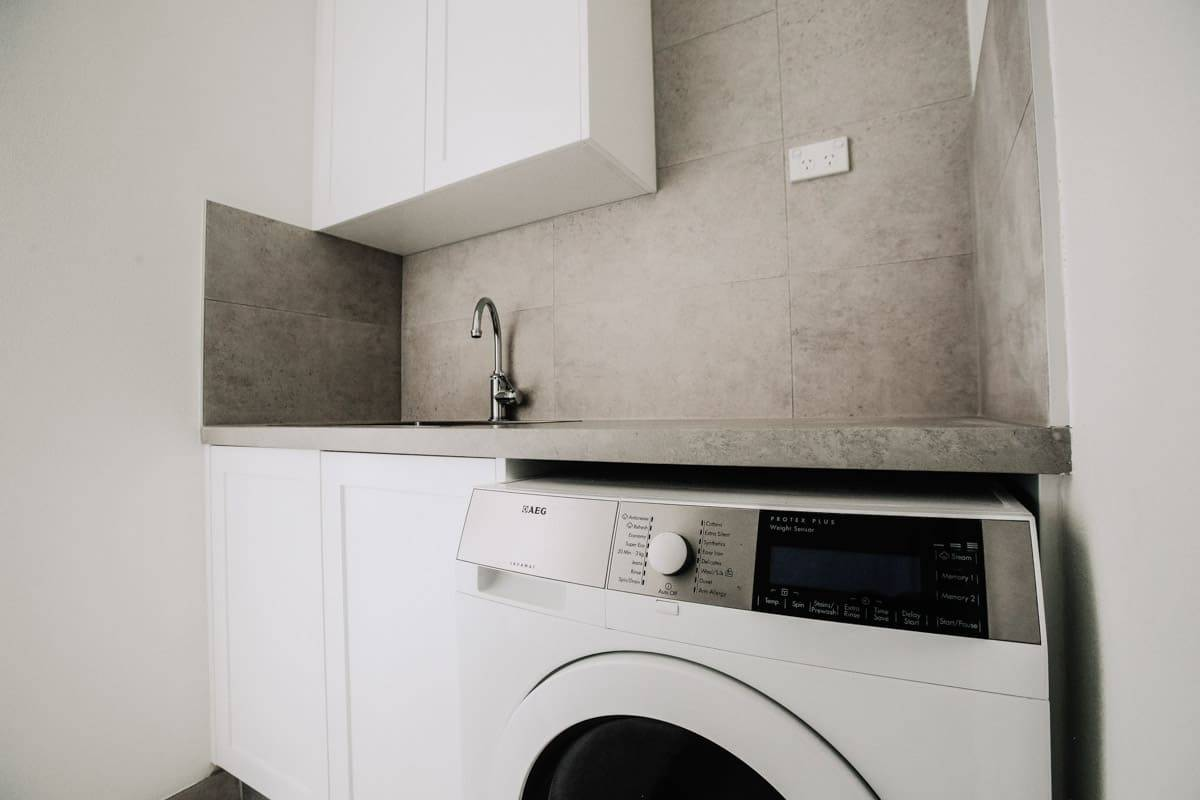 Combined-bathroom-and-laundry-renovation-company-in-Sydney-new-cabinets
