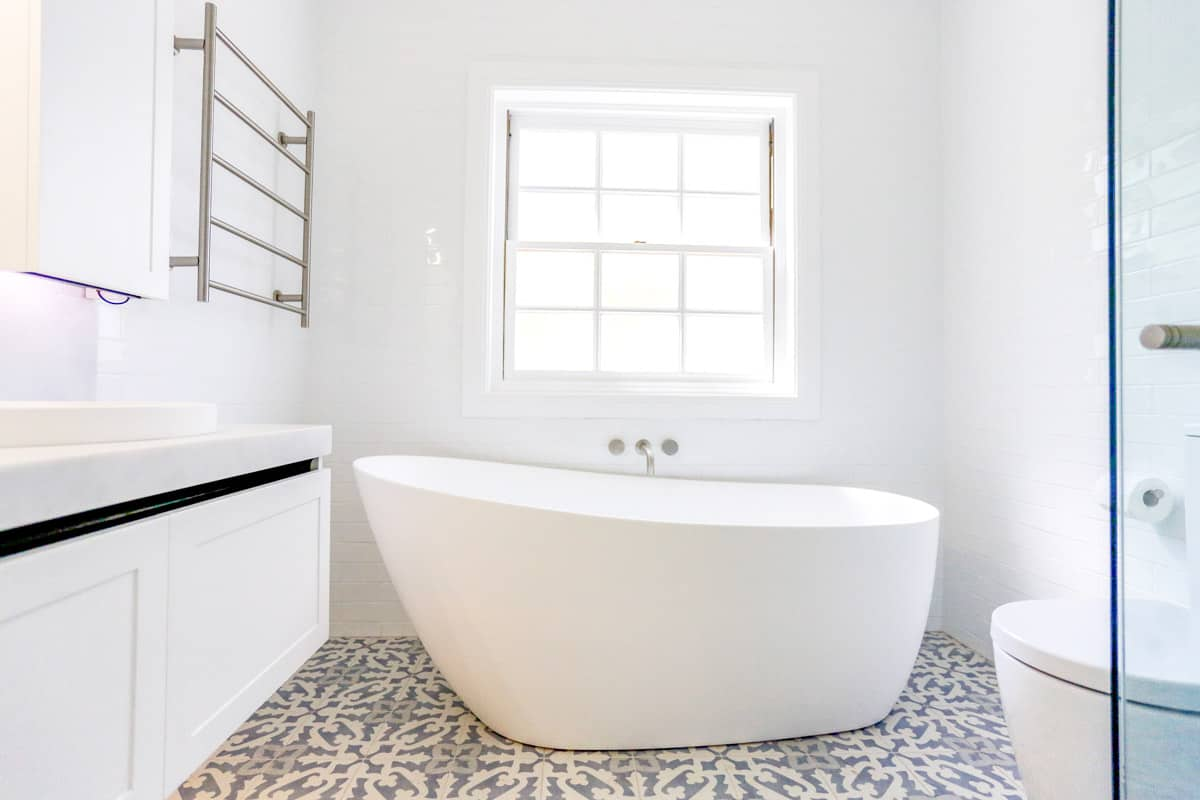 Kyle Bay Bathroom Renovation with free standing bath and frameless shower with double vanity by Nu-Trend renovation company in Sydney