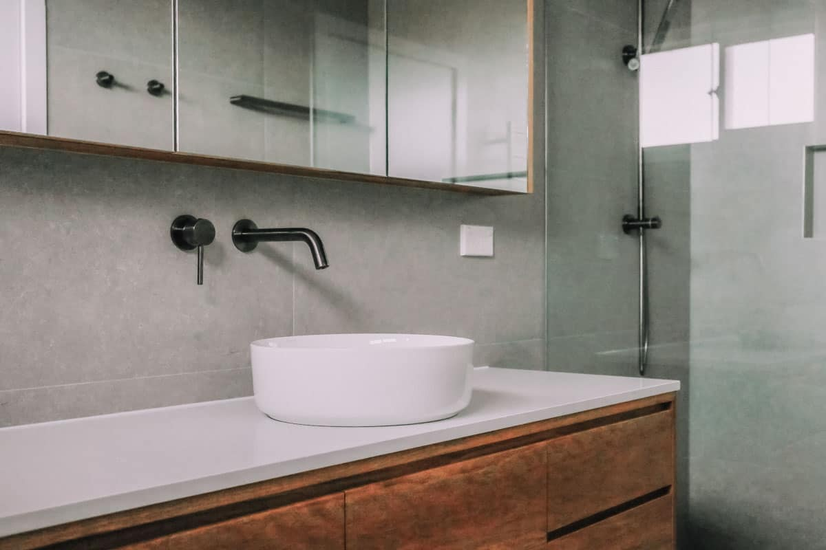 Nu-Trend-Small-Bathroom-with-walk-in-shower-designed-with-ABI-Interiors-Elysian-Minimal-Mixer-tapware-and-Just-In-Place-Timber-Vanity