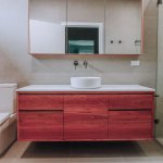 Nu-Trend-Small-Bathroom-with-walk-in-shower-designed-with-ABI-Interiors-tapware-and-Just-In-Place-Spotted-Gum-Timber-Vanity
