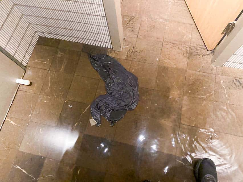 Nu-Trend plumbing fixing a blocked sewer drain in a restaurant shopping centre retail store water on the floor
