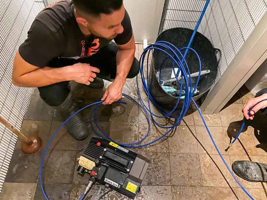 Nu-Trend plumbing fixing a blocked sewer drain in a restaurant shopping centre retail store with hot water high pressure jet blast
