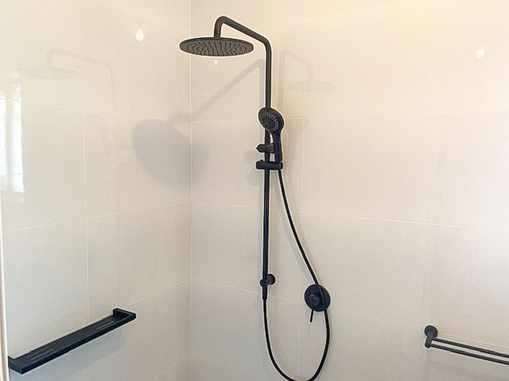 Small Bathroom Renovation for a unit in Hurstville Sydney by Nu-Trend Bathroom Renovations new shower head