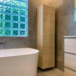 Small Bathroom Renovations in the Eastern Suburbs by Nu-Trend with a corner cupboard