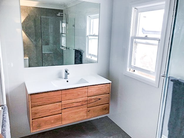 Small bathroom renovation in Alexandria with a custom made timber vanity from Eclipse Handcrafted Furniture with new sink and taps
