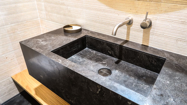 The beautiful sink area of a Nu-Trend master bathroom renovation designed by Boffi